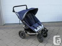 'Mountain Buggy' stroller in good condition. Buckles