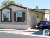 This doublewide mobile homes, located in sunny Mesa