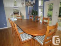 Solid wood table and chairs in good condition. Table
