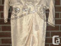 Ivory Silk dress in size 10.  Would suit a mature woman