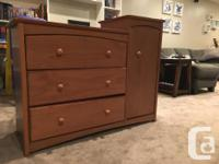 Three drawer dresser with attached hutch. Doubles as a