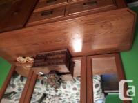 Selling a women's dresser solid oak, has a couple of