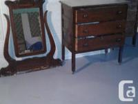 2 Antique Dressers & matching Hutch to one dresser .