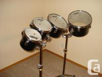 4 TAMA Toms with 2 heavy duty TAMA stands. Evans clear