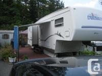 Full equiped, double slide outs, deck,wood stove,shed
