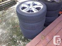One set of tires and rims, 205/50/17. One Toyo tire and