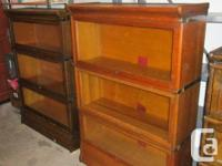 THERE ARE FOUR INDIVIDUAL OAK BOOKCASES FROM A CLEAN