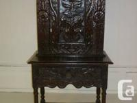 Highly hand carved solid oak cabinet c/w base drawer.