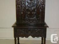 Highly hand carved solid oak cabinet c/w base drawer.