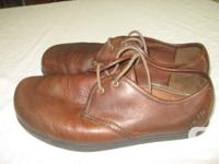 Brown leather, lightly worn, very comfy...but not for