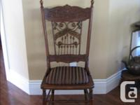 This unusual chair has wicker spindles and bobbins on