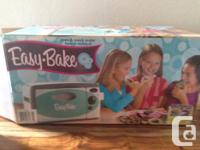 New easy bake oven used only once. Additionally comes