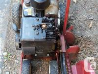 Snapper brand edger. Briggs and Stratton 2hp engine. It