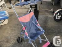stroller with fold-over cover for rain protection.