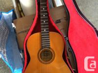 An El Degas guitar in excellent shape. Includes case &