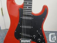 This is a used El Degas strat. I assume it was made in