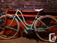 Mint green ladies Electra Amsterdam cruiser with white