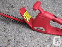 The Titan 2.2 amp 14-inch Electric Hedge Trimmer, has a