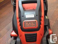 """Black & Decker 15"""" 10amp corded mower. Purchased end of"""