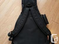 Asking $15 for a soft shell guitar case - never used!