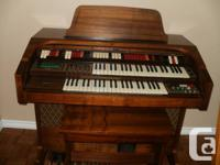 This lovely cherry wood organ has a beautiful sound. It