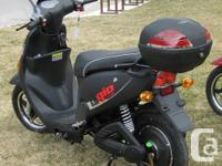 VERY NICE BRAND NEW BLACK ELECTRIC SCOOTER NO MILEAGE