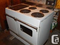 Electric 4-burner stove and oven, with wood-burning