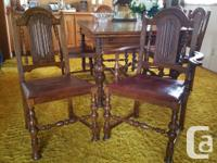 This grand dining room table and six chairs is looking