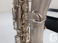 This antique alto sax was bought and restored, with all