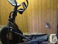 Elliptical trainer, has heart monitor, distance, time,