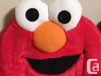 Elmo spin chair in very good condition. Elmo laughs