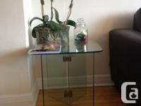 I am marketing my gorgeous glass end table, due to my