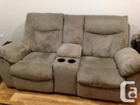 Power recliner chair couch with console containing a