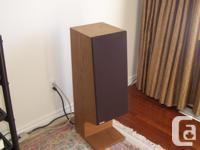 Energy Reference Connoisseur speakers finished in Oak.