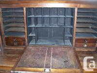 Late 1800s English Postmasters desk. It sits on two
