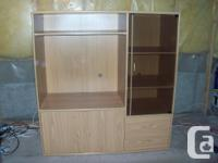 This strong wood entertainment system incudes a big