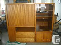 Oak wall unit with roll type sliding tv closure, glass