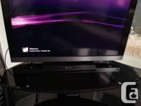 Large black tempered glass entertainment unit -