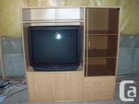 This solid wood entertainment unit incudes a large