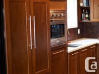 Beautiful custom made maple cabinetry only 2 years old.