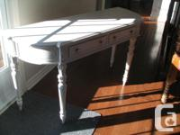 White rustic table available. It has two middle
