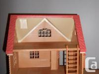 Beautiful vintage Sylvania family doll house with