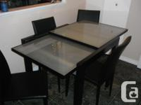 Tempered glass top expandable table and four chairs for