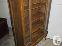 THIS OPEN FRONT CHINA CABINET IS 33 INCHES WIDE, 11 1/2