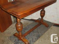 THIS OAK TABLE IS 22 INCHES DEEP, 48 INCHES WIDE AND 30