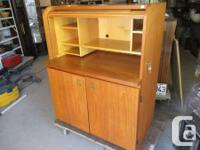 THIS TEAK OFFICE DESK IS 34 INCHES WIDE, 21 1/2 INCHES