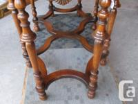 THIS ANTIQUE TABLE IS BEAUTIFUL. IT IS 24 INCHES WIDE,