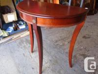 THIS HALF MOON END TABLE IS 12 INCHES DEEP, 24 INCHES