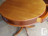 THIS TABLE IS 26 INCHES IN DIAMETER WITH A 4 1/2 INCH