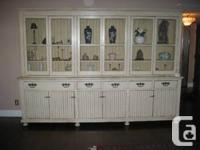 This exquisite large hutch in an antique beige color is